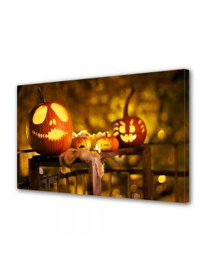 Tablou Canvas Halloween Dovleci sculptati pe masa